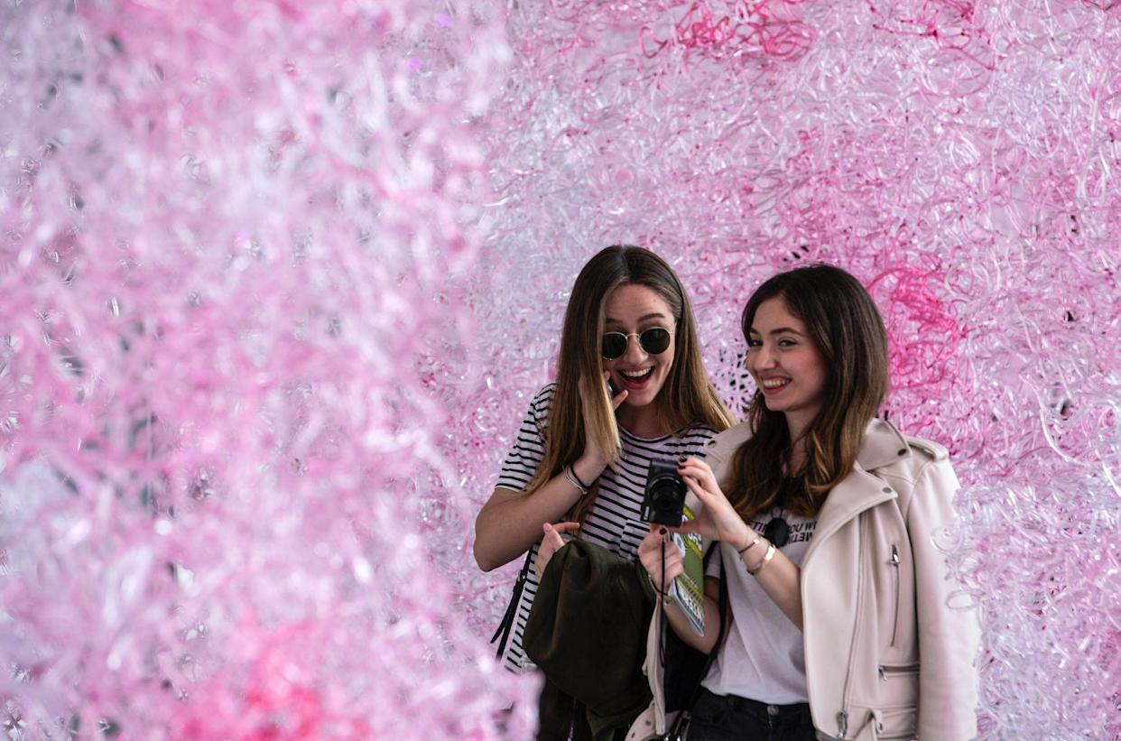 Two girls visit the installation 'Limbo' at the University of Milan on April 16, 2018 in Milan, Italy. (Photo: Emanuele Cremaschi/Getty Images)
