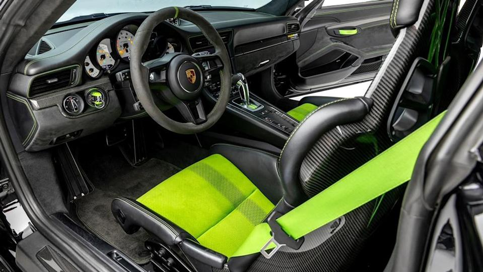 The racing-oriented interior features accents in Lizard Green, a color also found on the roll bar and brake calipers.  - Credit: Photo by Ted Seven, courtesy of Global Motorsports Group.