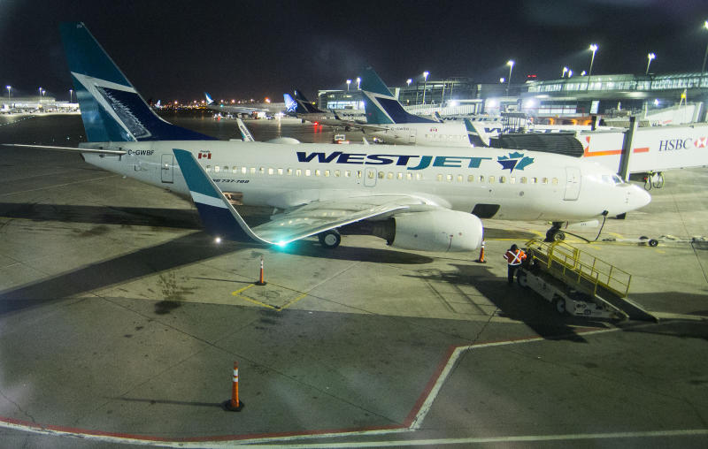 TORONTO, March 25, 2020. Passenger planes of WestJet are seen at Pearson International Airport in Toronto, Canada, March 24, 2020. Canada's second largest airline WestJet on Tuesday announced to lay off 6,900 employees due to the impact of the COVID-19 pandemic. Nearly two-thirds of the airline's fleet of 120 aircrafts are currently grounded. (Photo by Zou Zheng/Xinhua via Getty) (Xinhua/Zou Zheng via Getty Images)