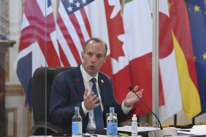 Britain's Foreign Secretary Dominic Raab, addresses G7 foreign minister, while being socially distanced as they meet in London, during talks at the G7 Foreign and Development Ministers meeting Tuesday May 4, 2021. (Stefan Rousseau/Pool via AP)