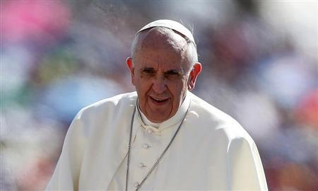 Pope Francis arrives to lead his Wednesday general audience in Saint Peter's square at the Vatican