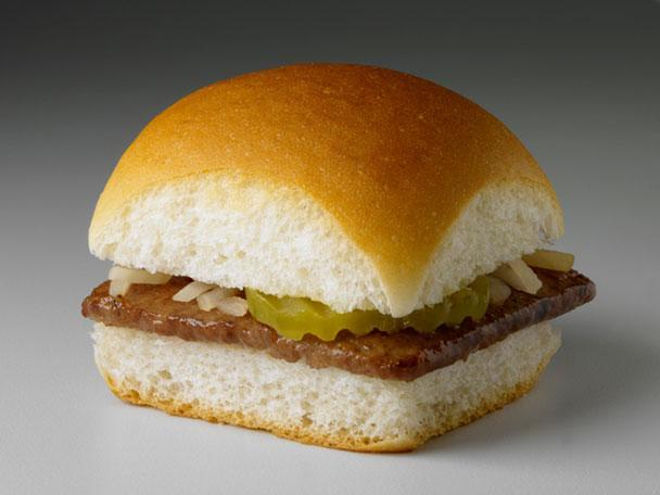 """<div class=""""caption-credit""""> Photo by: Photo: White Castle System Inc.</div><b>5. White Castle Original Sliders</b> <br> Smaller portions have led to huge success for the nation's first hamburger fast-food chain, White Castle, which opened its doors in 1921, serving tiny thin-pattied sandwiches known as sliders (or """"Slyders,"""" as they trademarked them). A majority of food historians would agree that the savory snack was so named for its characteristic ability to slide right down your throat. With 18.5 billion burgers sold to date, White Castle's menu has since expanded to include slider-size chicken and fish sandwiches, as well as chicken rings (a circular take on classic chicken tenders). <br> <b>More from Gourmet:</b> <br> <b><a href=""""http://www.gourmet.com/recipes/menus/2008/08/burger-slideshow?mbid=synd_yshine"""" rel=""""nofollow noopener"""" target=""""_blank"""" data-ylk=""""slk:Gourmet's 12 Best Burgers of All Time"""" class=""""link rapid-noclick-resp"""">Gourmet's 12 Best Burgers of All Time</a> <br></b> <b><a href=""""http://www.gourmet.com/recipes/2000s/2009/03/sandwiches-of-the-world-slideshow#slide=1?mbid=synd_yshine"""" rel=""""nofollow noopener"""" target=""""_blank"""" data-ylk=""""slk:The Best Sandwiches Around the W"""" class=""""link rapid-noclick-resp"""">The Best Sandwiches Around the W</a></b>"""