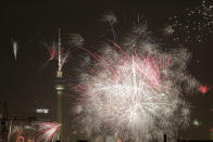 Fireworks light the sky near the Television Tower during New Year celebrations in Berlin, Wednesday, Germany, Jan. 1, 2020. (AP Photo/Markus Schreiber)