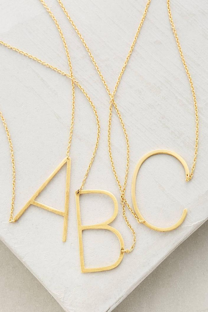 """<p><strong>Anthropologie</strong></p><p>anthropologie.com</p><p><strong>$38.00</strong></p><p><a href=""""https://go.redirectingat.com?id=74968X1596630&url=https%3A%2F%2Fwww.anthropologie.com%2Fshop%2Fblock-letter-monogram-necklace%3Fcolor%3D901%26type%3DSTANDARD%26size%3DOne%2BSize%26quantity%3D1&sref=https%3A%2F%2Fwww.countryliving.com%2Fshopping%2Fgifts%2Fg25323076%2Fnew-mom-gifts%2F"""" rel=""""nofollow noopener"""" target=""""_blank"""" data-ylk=""""slk:Shop Now"""" class=""""link rapid-noclick-resp"""">Shop Now</a></p><p>Despite all the talk about how hard motherhood is, there is absolutely nothing like the love a new mom feels for her child. Wearing her baby's initial around her neck will keep him or her close to her heart. </p>"""