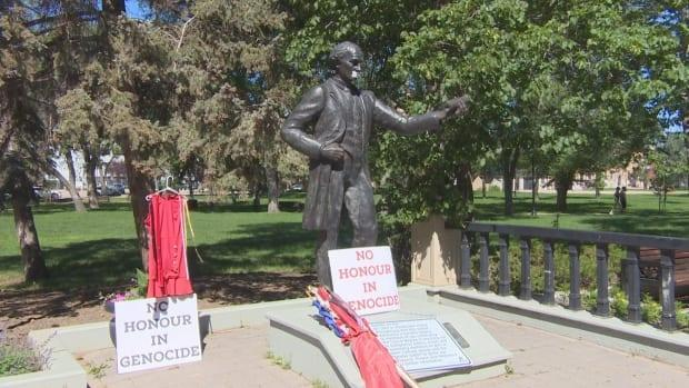 A red dress, meant to honour and represent missing and murdered Indigenous women and girls, was hung beside the statue of John A. Macdonald in Victoria Park last summer. For months the city has been doing consultations about the statue and its place in Victoria Park.