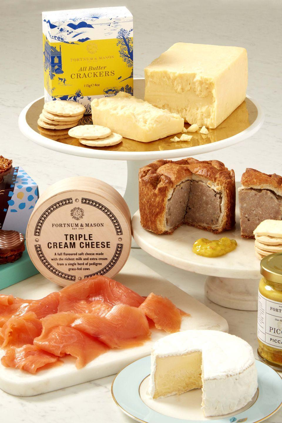 "<p>Nothing says picnic season quite like a Fortnum & Mason spread, and for summer 2020 there's an exciting selection of new offerings to fill your hamper up to the brim with. Alongside iconic favourites like Fortnum's traditional scotch eggs (£22 for six), smoked cheese straws (£5.95 per box) and jars of Piccalilli (£10.95), why not try a pot of truffle & honey stilton (£14.95), or chicken, roasted red pepper and nduja pie (£7.95). Drinks-wise, you can't beat a chilled bottle of non-alcoholic sparkling tea or a refreshing glass of the apricot and cherry cold brew infusion. The Food Halls of the Piccadilly and St Pancras International stores are now open.</p><p><a href=""https://www.fortnumandmason.com"" rel=""nofollow noopener"" target=""_blank"" data-ylk=""slk:www.fortnumandmason.com"" class=""link rapid-noclick-resp"">www.fortnumandmason.com</a></p>"