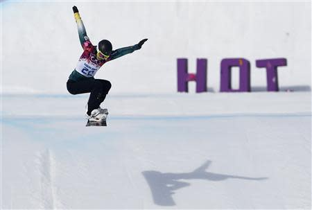 Australia's Torah Bright performs a jump during the women's snowboard cross qualification round at the 2014 Sochi Winter Olympic Games in Rosa Khutor February 16, 2014. REUTERS/Dylan Martinez