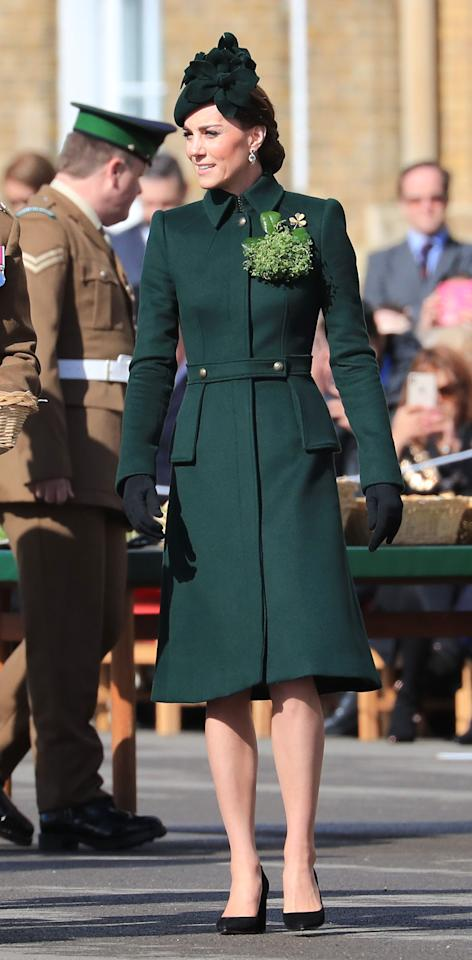 For the St Patrick's Day parade with the Irish Guards, Kate debuted a new custom-made green Alexander McQueen military-style coat, teaming it with a matching floral hat and her Gianvito Rossi pumps. She accessorised with her Kiki McDonough green tourmaline and green amethyst earrings, and the Cartier shamrock brooch. [Photo: PA]