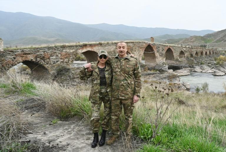 The couple took pictures against the backdrop of the mediaeval Khudaferin bridge at the country's border with Iran