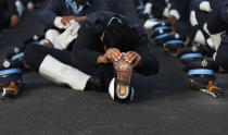 An Indian Air Force soldier stretches during a break in between practice for the upcoming Republic Day parade in New Delhi, India, Thursday, Jan. 21, 2021. Republic Day marks the anniversary of the adoption of the country's constitution on Jan. 26, 1950. Thousands congregate on Rajpath, a ceremonial boulevard in New Delhi, to watch a flamboyant display of the country's military power and cultural diversity. (AP Photo/Manish Swarup)