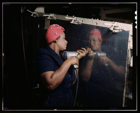 """A woman operates a hand drill on a """"Vengeance"""" dive bomber at Vultee-Nashville, Tennessee in this February 1943 Library of Congress handout photo"""
