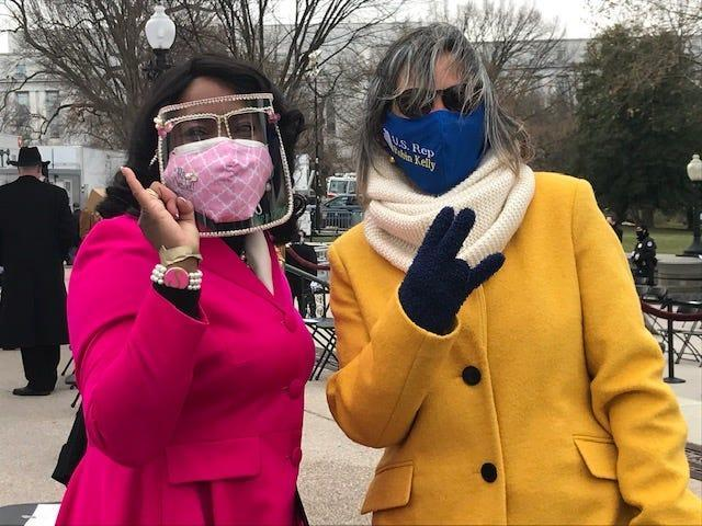 Rep. Terri Sewell, D-Ala., left, is decked out in the pink and green of Alpha Kappa Alpha Sorority, and Rep Robin Kelly, D-Ill., wears the blue and gold of Sigma Gamma Rho Sorority at the U.S. Capitol for President Joe Biden's inauguration on Jan. 20, 2021. Vice President Kamala Harris is a member of AKA.