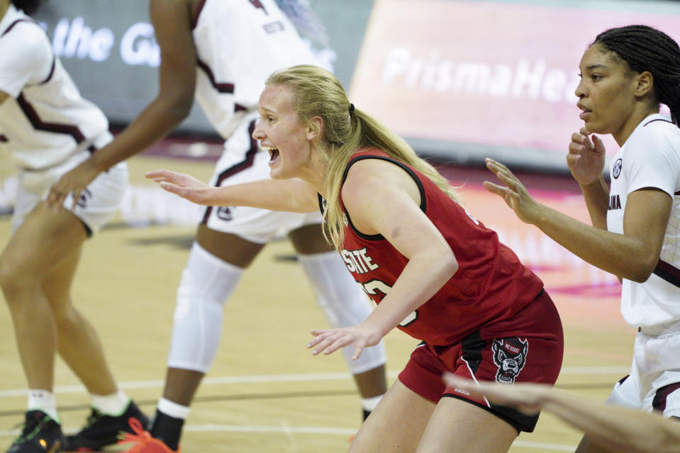 North Carolina State center Elissa Cunane, left, calls for the ball, next to South Carolina forward Victaria Saxton during the first half of an NCAA college basketball game Thursday, Dec. 3, 2020, in Columbia, S.C. N.C. State won 54-46. (AP Photo/Sean Rayford)