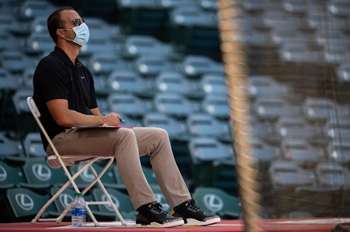 Angels general manager Billy Eppler watches an Angels intrasquad game at Angel Stadium in July 2020.
