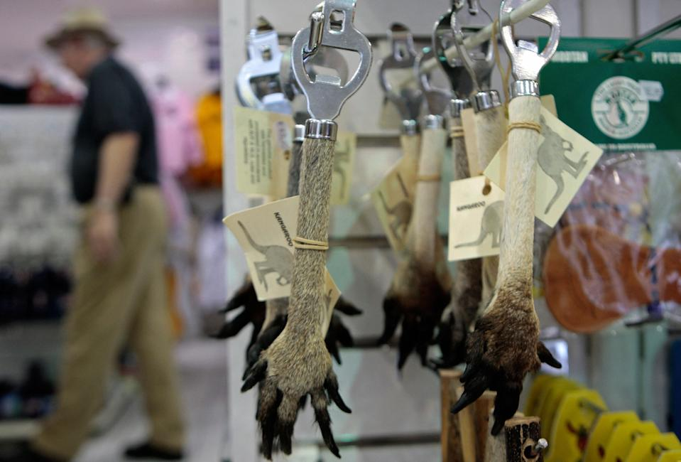 Kangaroo paw souvenir items, like these one pictured hanging off a rack inside a shop, continue to be sold in Australia.