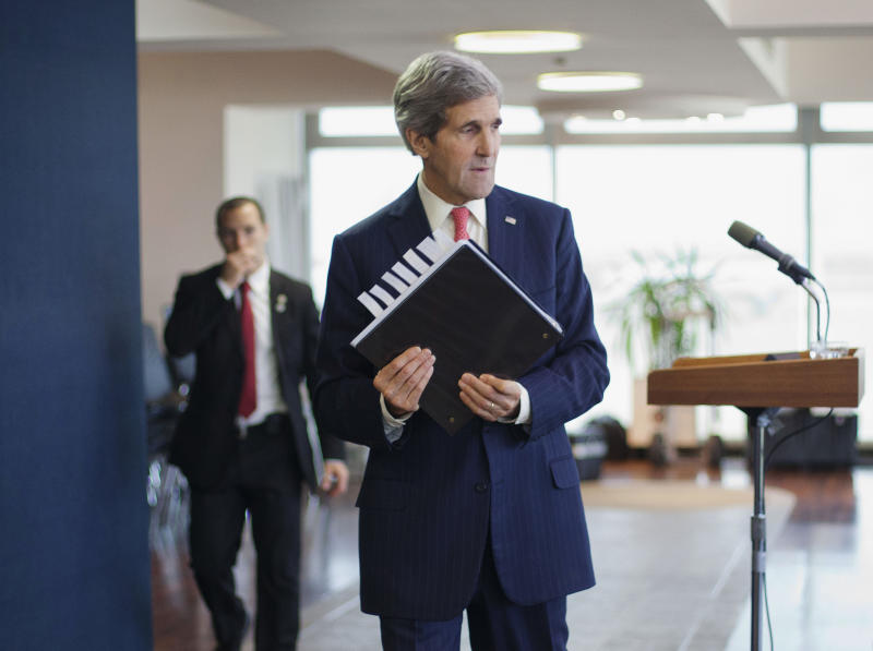 U.S. Secretary of State John Kerry picks up his notebook after answering questions from members of the media before his departure from Ben Gurion International Airport in Tel Aviv on Friday, Dec. 6, 2013. Kerry spoke about his visit to Jerusalem and Ramallah to discuss Israeli-Palestinian peace and to consult Israeli officials about Iran. (AP Photo/Pablo Martinez Monsivais, Pool)