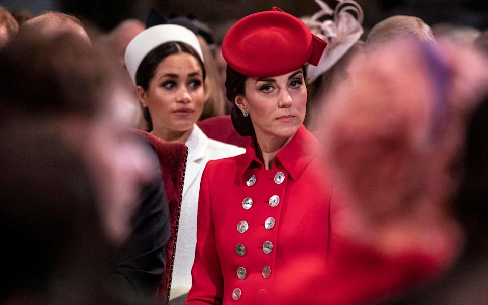 Duchess of Cambridge sits near the Duchess of Sussex as they attend the Westminster Abbey Commonwealth day service - Times Newspapers Ltd