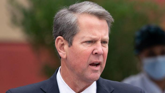 "Georgia Gov. Brian Kemp (above) told Fox News he would ""absolutely"" support former President Donald Trump if he was the Republican nominee in 2024. (Photo by Sean Rayford/Getty Images)"