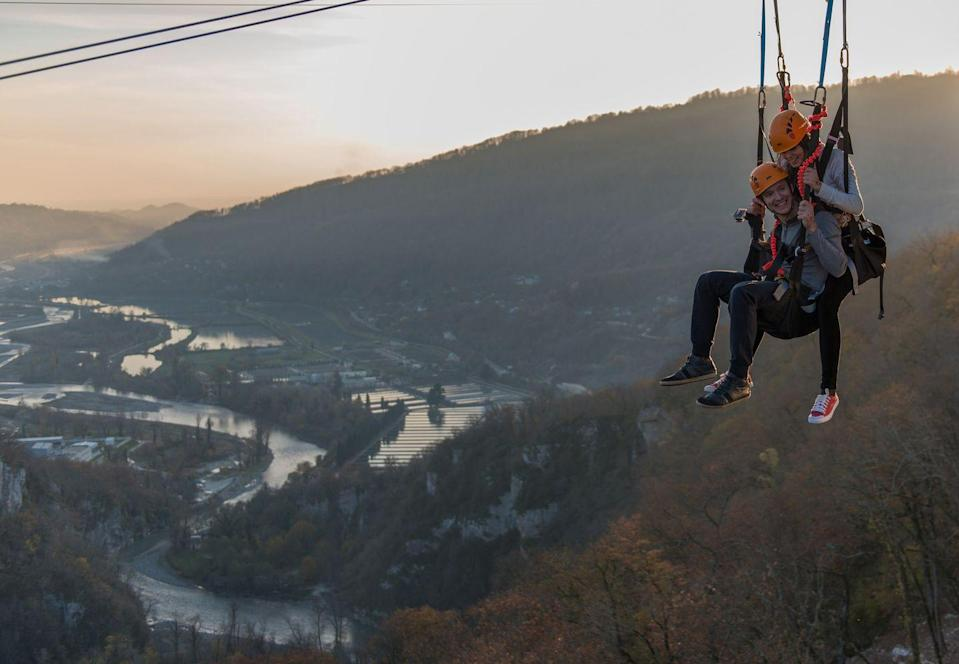 """<p>Imagine a beautiful canyon view. It's breathtaking. It's Instagram-worthy. But it's just not heart-attack-inducing. The swing at Skypark Sochi fixes that. It starts at a dizzying height of 558 feet, then plunges riders down and across a 1,640-foot canyon. Oh, and to get there, riders have to cross the <a href=""""https://www.dailymail.co.uk/travel/travel_news/article-2847209/World-s-highest-swing-SochiSwing-opens-Russia-sending-daredevils-flying-1-640ft-picturesque-ravine.html"""" rel=""""nofollow noopener"""" target=""""_blank"""" data-ylk=""""slk:longest suspension footbridge"""" class=""""link rapid-noclick-resp"""">longest suspension footbridge</a> in the world. </p>"""