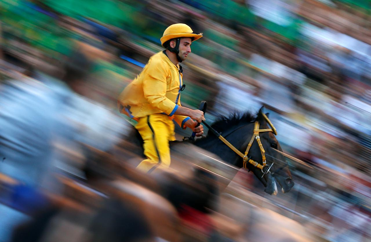 """Jockey Carlo Sanna of  """"Aquila"""" (Eagle) parish rides his horse during the second practices for the Palio of Siena, Italy July 1, 2017. REUTERS/Stefano Rellandini"""