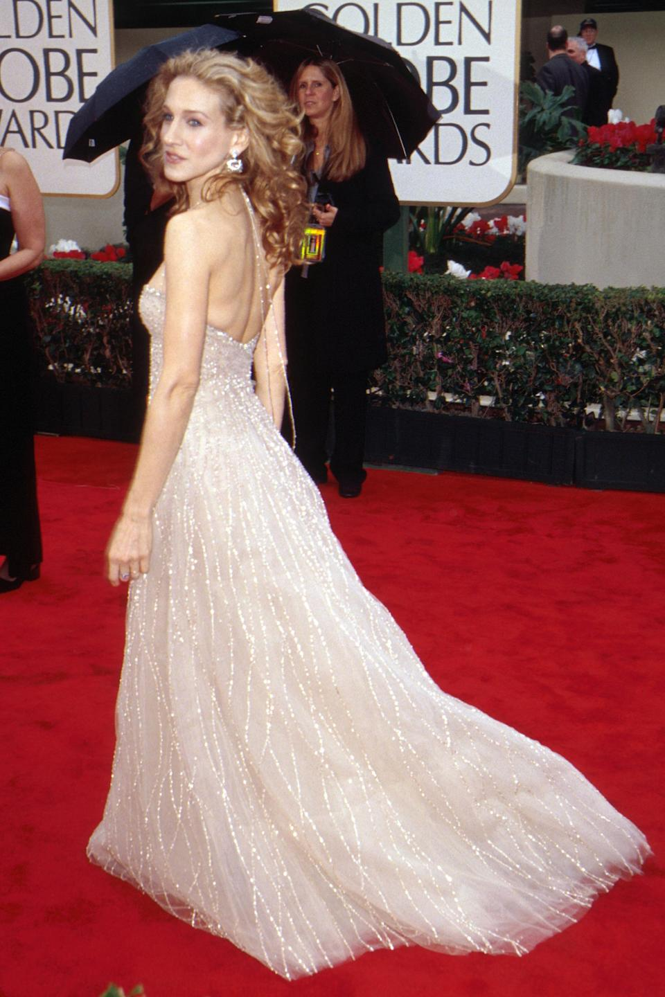 """<strong><h2>2000</h2></strong><br>At the height of <em>Sex And The City</em>'s prime, it hardly comes as a surprise that fashion icon Sarah Jessica Parker, would show up looking fabulous on the red carpet. We only wish she'd give us a hint to what shoes she's wearing underneath this Richard Tyler tulle gown.<br><br><em>Sarah Jessica Parker in Richard Tyler.</em><span class=""""copyright"""">Photo: Frank Micelotta/Getty Images.</span>"""