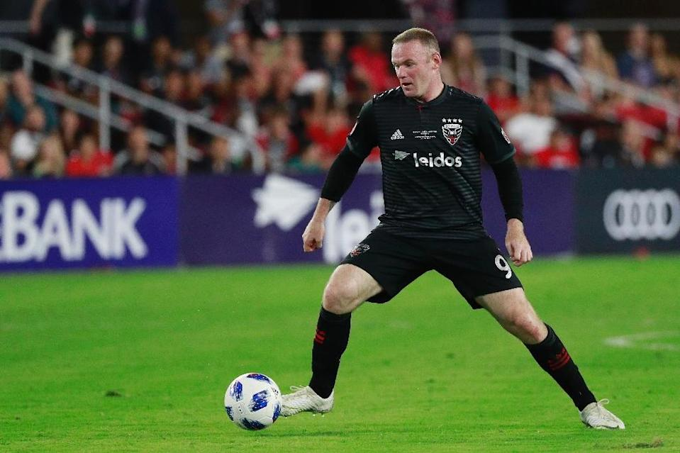 Wayne Rooney, pictured during an earlier match, curled home a low free-kick in the 27th minute to give United their first win in Columbus since 2007 (AFP Photo/Patrick McDermott)