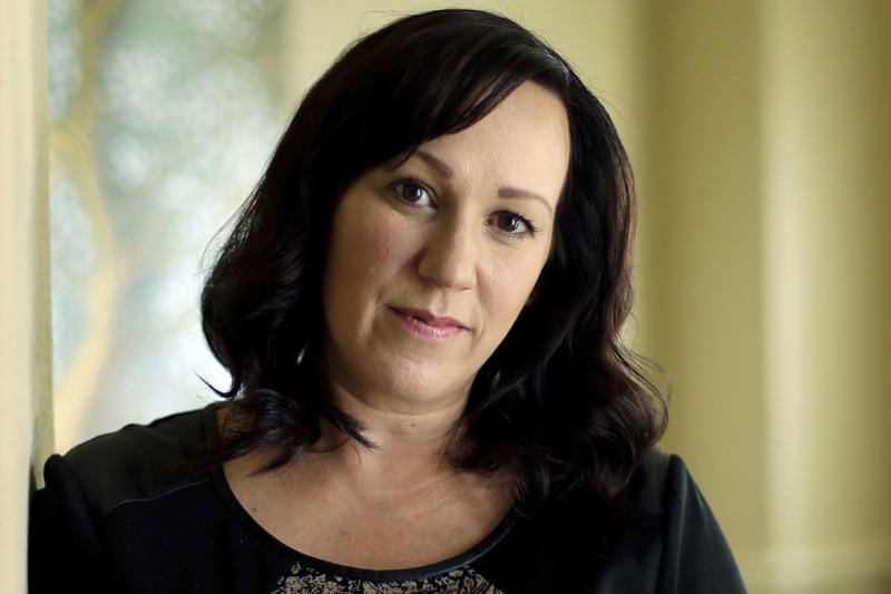 FILE - In this Aug. 9, 2018 file photo, MJ Hegar poses for a portrait at her home in Round Rock, Texas. Hegar of says she's running for U.S. Senate in 2020 against Republican incumbent John Cornyn. Hegar's announcement Tuesday, April 23, 2019, makes her the first Democrat to jump in the race against Cornyn, who's been in the Senate since 2002 and until this year was the No. 2 Republican in the chamber. (AP Photo/Eric Gay, File)