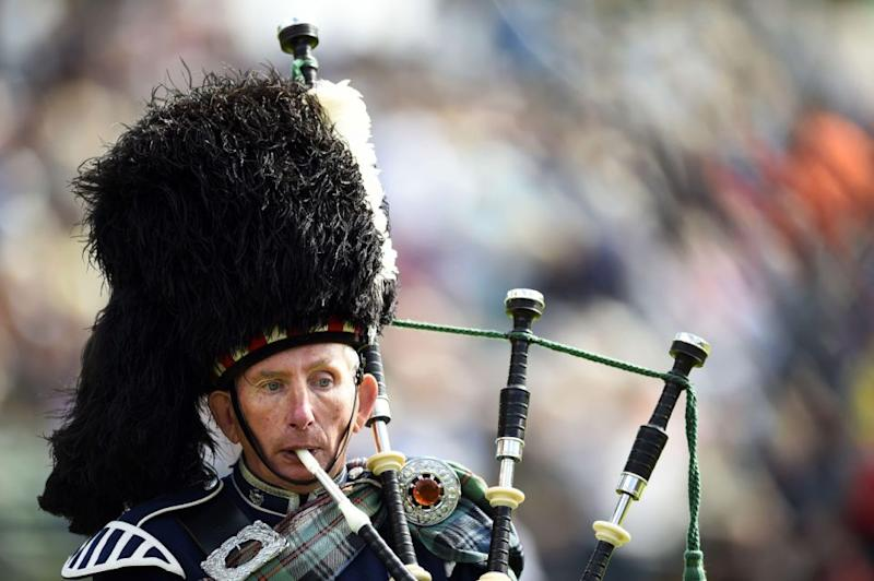 A royal piper plays outside of the Queen's bedroom window each morning. Photo: Getty