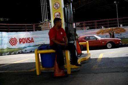 FILE PHOTO: The corporate logo of the state oil company PDVSA is seen at a gas station in Caracas, Venezuela August 29, 2017. REUTERS/Carlos Garcia Rawlins/File Photo