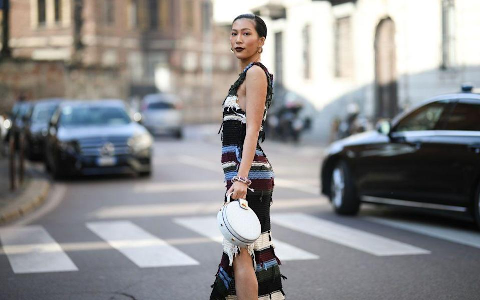 """<p>You'd be forgiven for confusing the knitted dress with its weightier little sister, the <a href=""""https://www.harpersbazaar.com/uk/fashion/what-to-wear/news/g37237/best-jumper-dresses/"""" rel=""""nofollow noopener"""" target=""""_blank"""" data-ylk=""""slk:jumper dress"""" class=""""link rapid-noclick-resp"""">jumper dress</a>, but grasping the distinction is key to switching up your wardrobe this summer.</p><p>Tiered midis, roomy maxis and smocks – we can't be the only ones tiring of the 'comfy chic' choices out there. Thrilled at first to peel off the loungewear in favour of these summery options post-lockdown, now we're looking for an upgrade. And the knitted dress' renaissance couldn't have come at a better time. Ribbed, crocheted or deftly looped to create a sculptural silhouette, it's impossibly chic, and yet, due to the stretchy nature of knit fabrics, never ceases to be comfortable.</p><p>If you were one of the few lamenting the decline of bodycon clothing, this one is for you. But it's also appropriate if you steer clear of anything too clingy – the beauty of knitted numbers is in their drape. The most sculptural (read: directional) styles are often the most figure-flattering; smoothing the waist and flaring out to create an hourglass shape.</p><p>But if it's not the shape you're concerned with so much as the density, remember that knitwear is not just for winter. Wool is a great temperature-regulator, but cotton (think of crochet), silk (the classic men's tie) and synthetic yarns can also be knitted.</p><p><strong>From floor-sweeping flared maxis to '90s-inspired ribbed slips, here are 10 of the best knitted dresses to shop this summer. </strong></p>"""