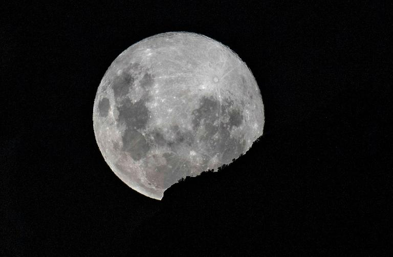 A supermoon -- when the moon reaches its closest position to the Earth -- rises over Santiago, on April 7, 2020