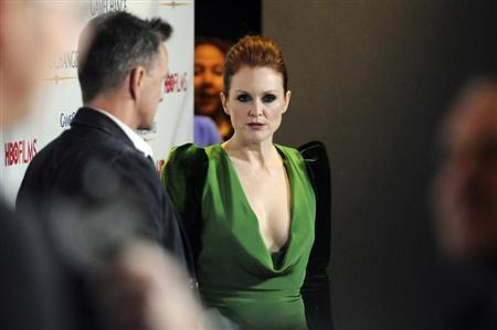 "Moore walks the red carpet for a viewing party for the new film ""Game Change"" at the Newseum in Washington"