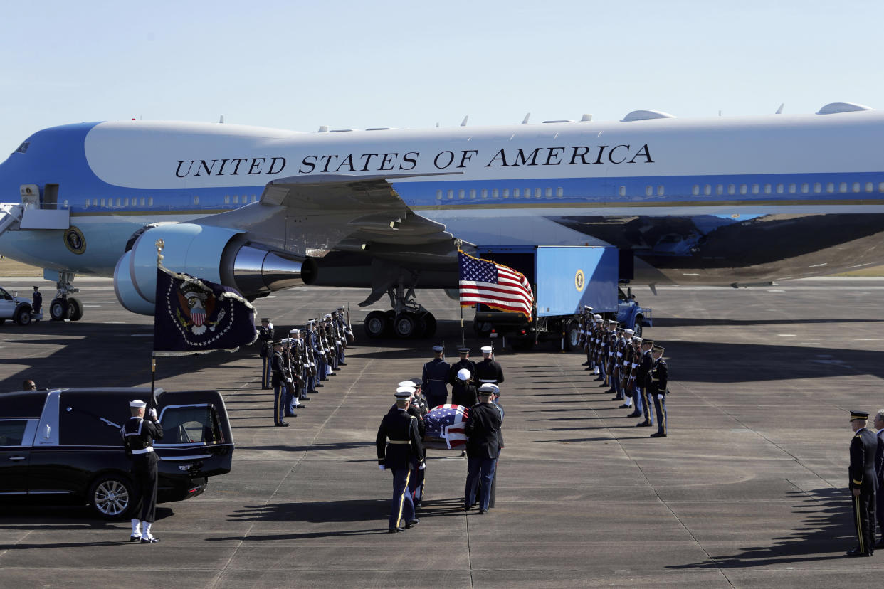 Members of the military carry the casket to Special Air Mission 41at Ellington Field during a departure ceremony for a state funeral for former President George H.W. Bush, Monday, Dec. 3, 2018, in Houston. (Photo: Eric Gay/AP)