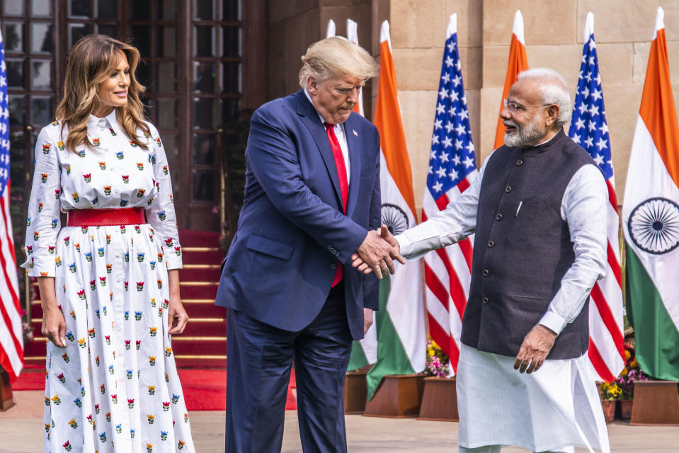 File Photo: Prime Minister Narendra Modi with US President Donald Trump and First Lady Melania Trump in New Delhi. (Photo by Pradeep Gaur/Mint via Getty Images)