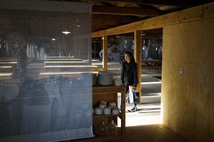 Lori Matsumura visits a replica mess hall at the Manzanar National Historic Site near Independence, Calif., Monday, Feb. 17, 2020. Matsumura's father and his family were among the more than 10,000 Japanese Americans imprisoned at the Manzanar War Relocation Center during World War II. Her grandfather, Giichi Matsumura, died when he left the camp to explore the nearby high Sierra in 1945. Hikers discovered his mountainside grave and unearthed the skeleton in 2019, leading authorities to retrieve the bones and return them to the Matsumura family. (AP Photo/Brian Melley)