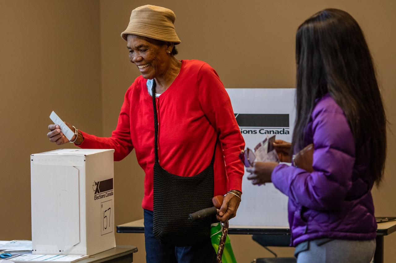People vote at a polling station at the Assembly Hall for Canada's 43rd general election October 21, 2019 in Etobicoke, Ontario, Canada. Liberal party leader Justin Trudeau is neck and neck with Conservative Leader Andrew Scheer, as they both attempt to be elected the country's Prime Minister. (Photo by Brett Gundlock/Getty Images)