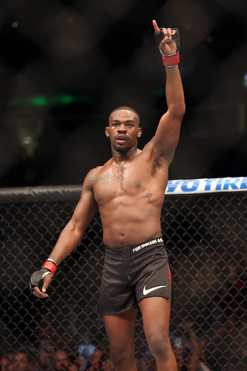Champion Jon Jones celebrates after beating Chael Sonnen in their  UFC 159 Mixed Martial Arts light heavyweight title bout in Newark, N.J., Saturday, April 27,2013.  Jones retained his title via  first round TKO. (AP Photo/Gregory Payan)