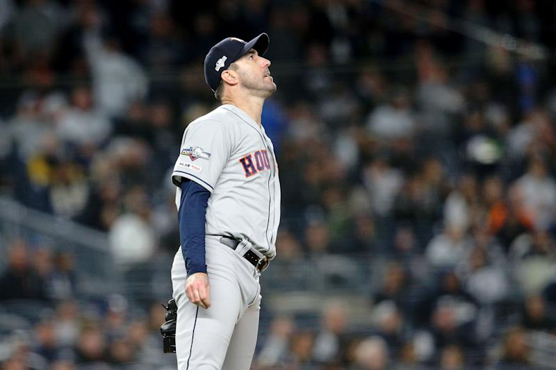 Oct 18, 2019; Bronx, NY, USA; Houston Astros starting pitcher Justin Verlander (35) watches the home run of New York Yankees first baseman DJ LeMahieu (not pictured) during the first inning of game five of the 2019 ALCS playoff baseball series at Yankee Stadium. Mandatory Credit: Brad Penner-USA TODAY Sports
