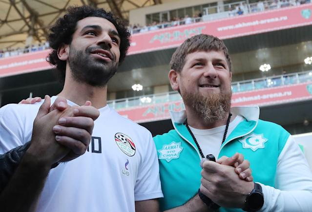 Egyptian national football team player and Liverpool's star striker Mohamed Salah (L) poses with head of the Chechen Republic Ramzan Kadyrov during a training at the Akhmat Arena stadium in Grozny on June 10, 2018, ahead of the Russia 2018 World Cup. – Egypt's national football team will use the venue as their base camp training site. (Getty Images)