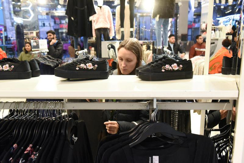 FILE PHOTO: A woman shops at an H&M store in New York City