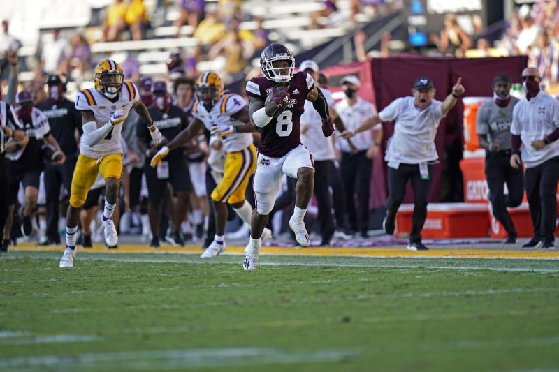 Kylin Hill (8) made a huge impression in Mississippi State's upset of defending national champion LSU in Baton Rouge. (AP Photo/Gerald Herbert)