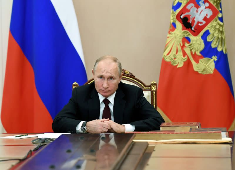 FILE PHOTO: Russian President Putin attends a meeting with heads of religious confessions on the National Unity Day, via a video conference call in Moscow