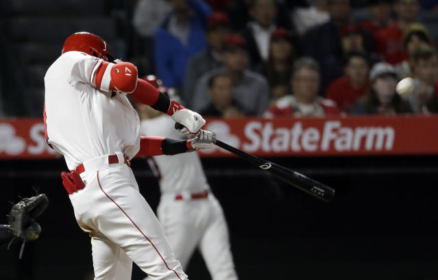 Los Angeles Angels' Shohei Ohtani hits a two-run home run against the Oakland Athletics during the sixth inning of a baseball game Tuesday, June 4, 2019, in Anaheim, Calif. (AP Photo/Marcio Jose Sanchez)