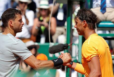 Tennis - ATP - Monte Carlo Masters - Monte-Carlo Country Club, Monte Carlo, Monaco - April 21, 2018 Bulgaria's Grigor Dimitrov shakes hands with Spain's Rafael Nadal after winning their semi-final match REUTERS/Eric Gaillard