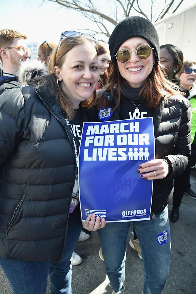 <p>Julianne Moore, right, poses with a sign in Washington, D.C. (Photo: Getty Images) </p>