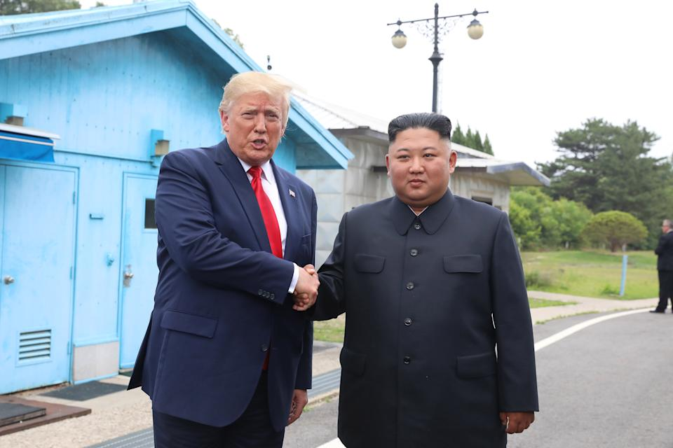 A handout photo provided by Dong-A Ilbo of North Korean leader Kim Jong Un and U.S. President Donald Trump inside the demilitarized zone (DMZ) separating the South and North Korea on June 30, 2019 in Panmunjom, South Korea. (Handout photo by Dong-A Ilbo via Getty Images/Getty Images)