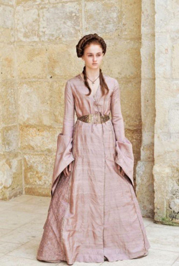 <p>Even in mourning, Sansa doesn't wear black. In fact, she goes the complete opposite, wearing a cheery, rosie pink. This is the first sign that Sansa knows she has to hide her true feelings if she wants to survive under Joffrey's rule. </p>
