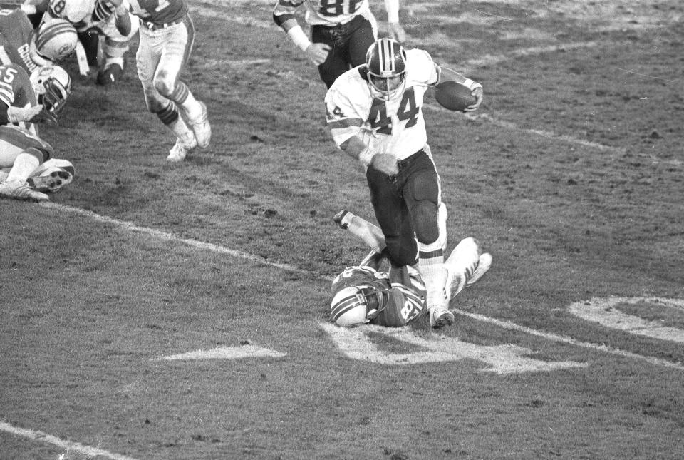 FILE - In this Jan. 30, 1983, file photo, Washington Redskins running back John Riggins (44) breaks away from Miami Dolphins cornerback Don McNeal on his way to the winning touchdown in fourth-quarter action in Super Bowl XVII in Pasadena, Ca. Washington turned into a run-heavy offense in the second half and that led to Riggins memorable run off left tackle against a tiring Miami defense. (AP Photo, File)