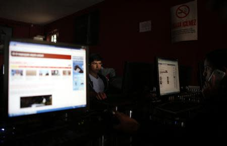 People use computers at an internet cafe in Ankara