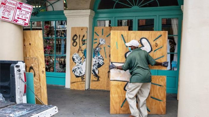 Businesses in New Orleans were being boarded up in preparation for the hurricane